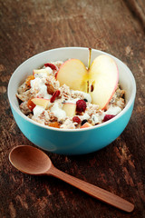 Fruit Slices with Yogurt on Bowl at Wooden Table