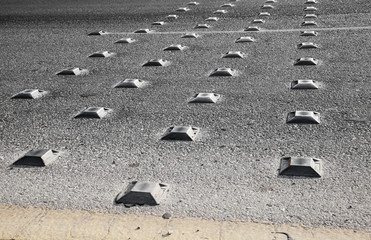 Metal road studs on the asphalt highway