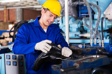 man working in a gumboot factory