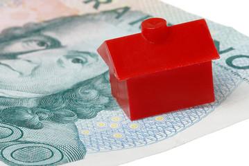 Rött litet hus på en sedel