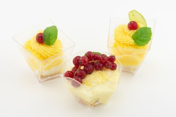 mini dessert with cream and currant