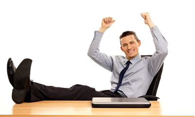 Cheerful young businessman with hands up