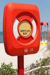 Safety life buoy in plastic case stand on the beach