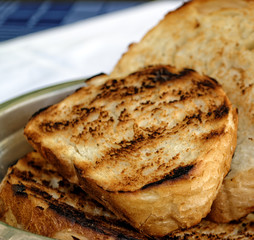 Fresh toasted sliced white bread in metal bowl