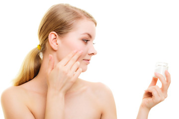 Skin care. Girl applying moisturizing cream
