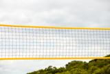 Fototapeta Volleyball summer sport. Net on a sandy beach