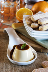 creme caramel with lady fingers and oranges