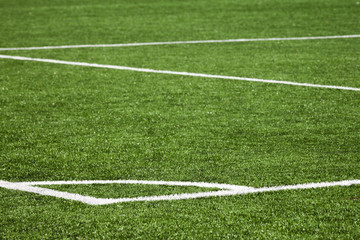 Football playing field background with white marking on green gr