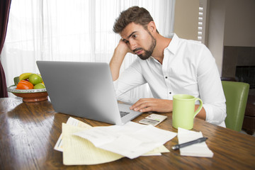 Unproductive man working at home looking for inspiration