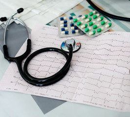 Stethoscope, pills and ECG