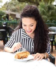 young woman enjoying a slice of cake