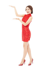 pretty asian young woman with cheongsam standing.