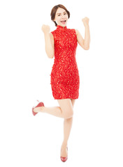 happy asian young woman with cheongsam raising hands