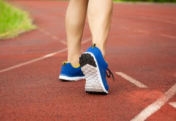 runner feet running on track. workout wellness concept