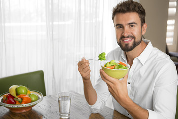 Portrait of a beautiful and lean gay man eating healthy