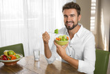 Fototapety Person drinking water and eating vegetables
