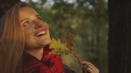Happy beautiful caucasian young woman in autumn park.