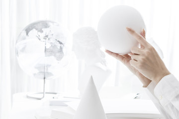 Hand holding a sphere