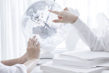 Woman pointing at globe