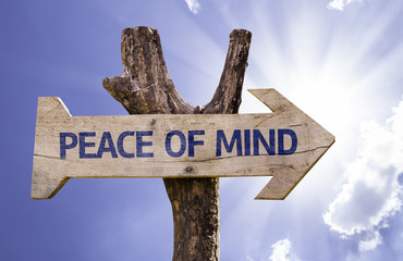 Peace of Mind wooden sign with a sky background
