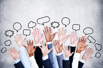 Business People's Arms Raised with Speech Bubbles