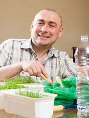 Man growing parsley and dill