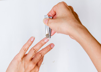 woman cutting fingernail.