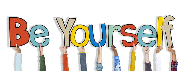 Group of Hands Holding Word Be Yourself