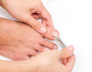 woman cut toenail with herself.