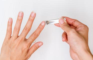 woman cut fingernail.