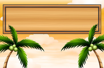 An empty wooden signboard with coconut trees