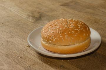 Hamburger bun on the wooden table