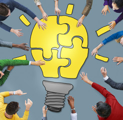 Business People with Light Bulb Jigsaw Symbol