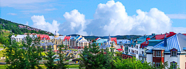 Mont tremblant village in blue sky and clouds.