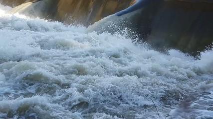 The water passes through the dam