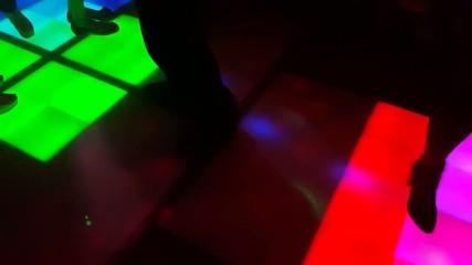 People dancing on the dance floor in a nightclub