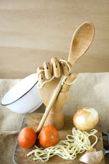 wooden hand holding spoon