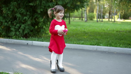 little girl in big shoes