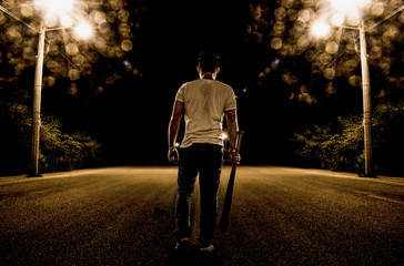 Baseball Fury, boy walking in the street at night