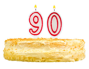birthday cake with candles number ninety isolated on white