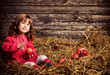 little girlwith apples on wooden background