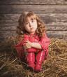 little girl on wooden background