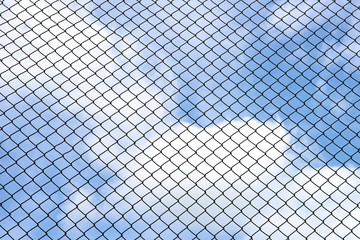 Silhouette wired fence with blur cloud and blue sky background