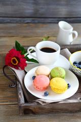 macaroon and coffee on tray