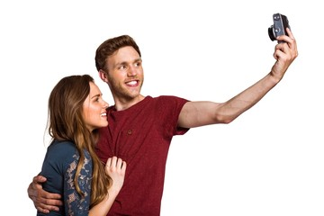 Couple taking selfie with digital camera