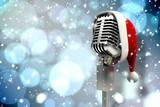 Fototapety Composite image of microphone with santa hat