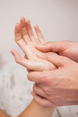 Manicurist washing customers hand