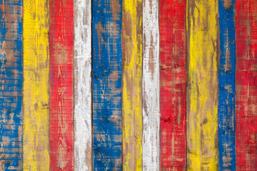 Colorful grungy wooden wall. Lining boards background texture