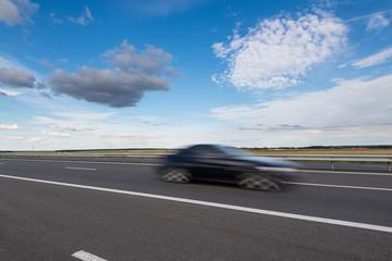 Fast blurred car in the freeway.