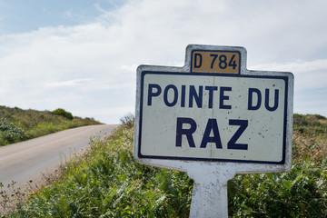 Pointe du Raz signal indication on the road. A rocky, dangerous